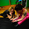 "KRISTOPHER RADDER - BRATTLEBORO REFORMER<br /> Aimee Hancock, director of the New England Center for Circus Arts' show, ""The Flying Nut 2016: Bratt in Bayou,"" helps Erin Ball about her routine on Tuesday, Dec. 13, 2016."