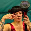 """KRISTOPHER RADDER - BRATTLEBORO REFORMER<br /> Aimee Hancock, director of the New England Center for Circus Arts' show, """"The Flying Nut 2016: Bratt in Bayou,"""" helps Erin Ball put on her stilts on Tuesday, Dec. 13, 2016."""