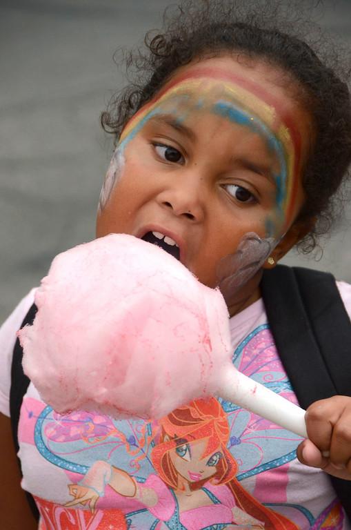 . Joy Davis, 6, enjoys cotton candy on North Street during Third Thursday on August 21, 2014. Gillian Jones/ Berkshire Eagle Staff / photos.berkshireeagle.com
