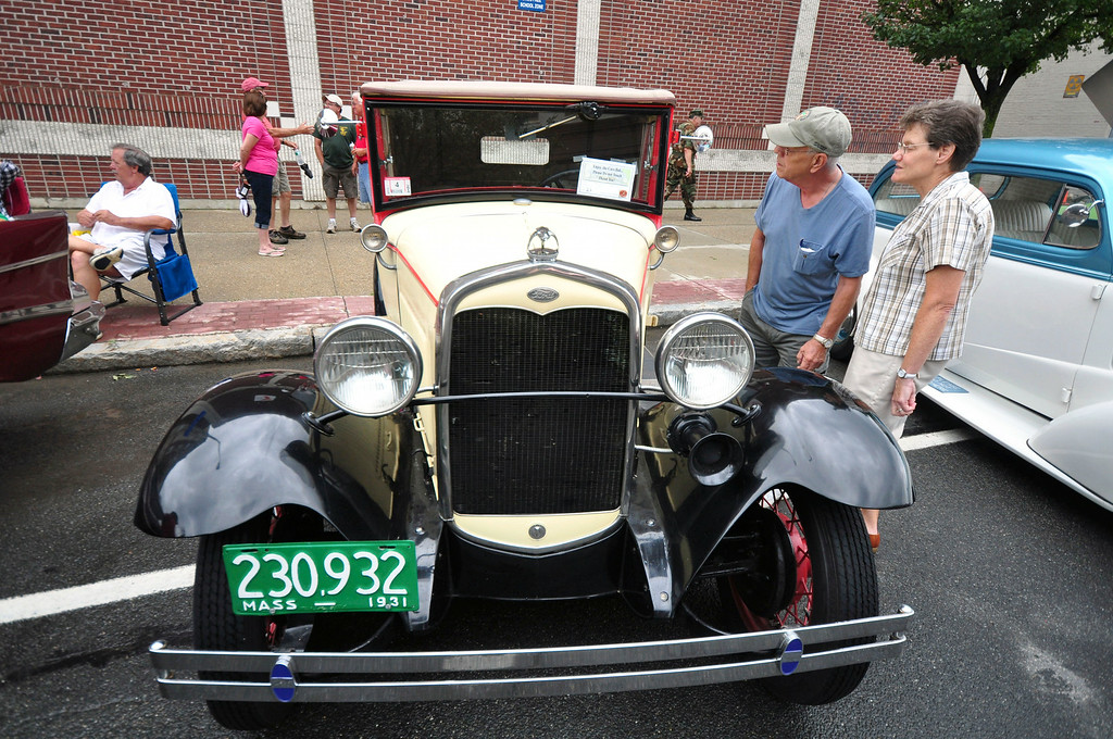 . People look at this 1931 Ford Model A owned by Gene E. Hyatt of Richmond, at the Pittsfield Ethnic Fair and Classic Car Show on North Street in Pittsfield on Sunday, July, 27, 2014. Gillian Jones / Berkshire Eagle Staff / photos.berkshireeagle.com