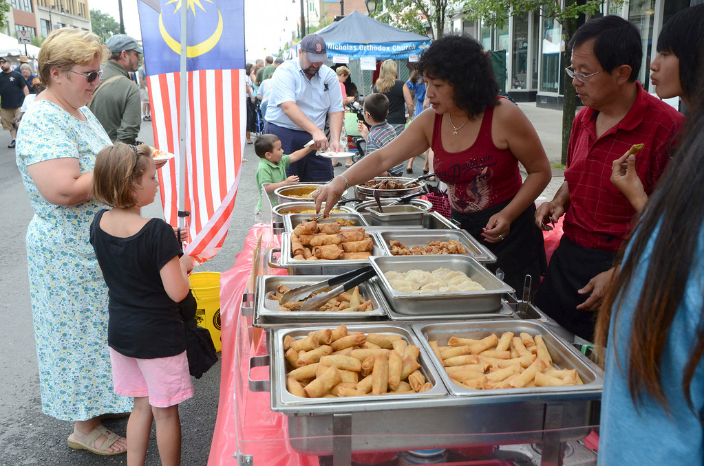 . People order food from Flavours of Malaysia, one of the many food vendors, at the Pittsfield Ethnic Fair and Classic Car Show on North Street in Pittsfield on Sunday, July, 27, 2014. Gillian Jones / Berkshire Eagle Staff / photos.berkshireeagle.com