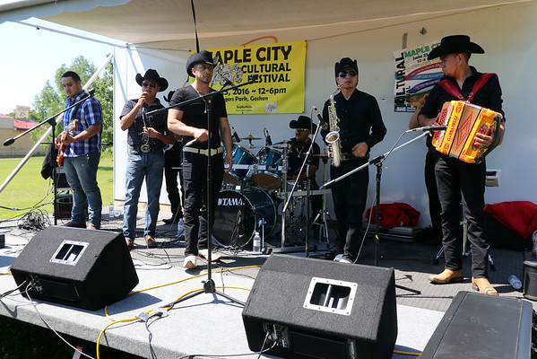 GEOFF LESAR | THE GOSHEN NEWS<br /> <br /> Esclavitud Norteña entertain the crowd Saturday at Maple City Cultural Festival.