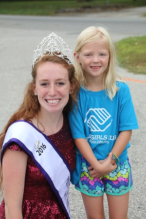 KRIS MUELLER | THE GOSHEN NEWS<br /> Eight-year-old, Evie Bonewitz, poses with Gabby Birr, the Elkhart County 4-H Fair Queen, at the Middlebury Summer Festival.