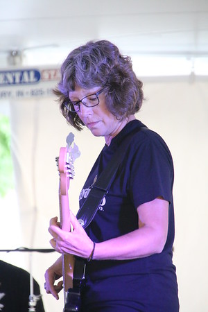 KRIS MUELLER | THE GOSHEN NEWS<br /> Carmen Whitman-plays the Bass Guitar with the guys from Dr. Jones & The Remed Friday at the Middlebury Summer Festival.
