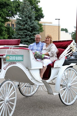 KRIS MUELLER | THE GOSHEN NEWS<br /> Kent and Becky Bontrager, this year's Grand Marshal's for the 48th Middlebury Summer Festival, smile during the parade Saturday. The Bontrager's own and operate Middlebury Produce.