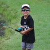 KRIS MUELLER | THE GOSHEN NEWS<br /> Rudy Chapman, 4 yrs old tries his hand at catch and release at the fishing contest Saturday morning at the Essenhaus' ponds during the Middlebury Summer Festival.