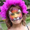 KRIS MUELLER | THE GOSHEN NEWS<br /> Makenzie Moore, 8 yrs old was transformed into a Lion Princess during the 48th Annual Middlebury Summer Festival.  Darlene Smithers had a booth offering face painting as well as henna designs.
