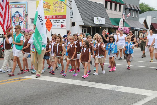 KRIS MUELLER | THE GOSHEN NEWS<br /> The Girls Scout Troop #377, Middlebury, walk in the parade as one of the Winners this year's 48th Annual Summer Festival Parade.