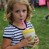 KRIS MUELLER | THE GOSHEN NEWS<br /> Bethany Rugg takes a long drink of her freshly squeezed lemon shakeup at the Middlebury Summer Festival.