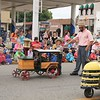 KRIS MUELLER | THE GOSHEN NEWS<br /> Freeman Yoder Tractors walk in the Middlebury Summer Festival Parade Saturday.