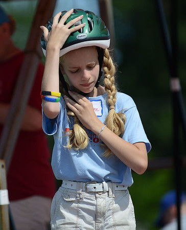 HALEY WARD | THE GOSHEN NEWS<br /> Madeline Hajicek puts on her helmet before racing in the Super Stock division during the Elkhart County Soap Box Derby on Saturday at the Elkhart County Fairgrounds. She finished second.