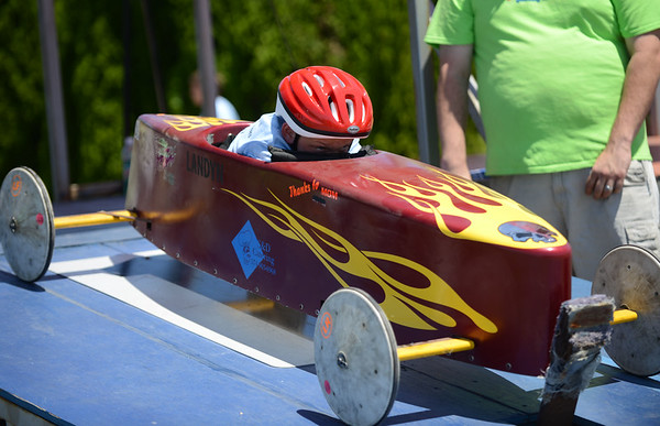 HALEY WARD | THE GOSHEN NEWS<br /> Landyn Connett races waits to race in the Elkhart County Soap Box Derby on Saturday at the Elkhart County Fairgrounds.
