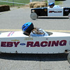 HALEY WARD | THE GOSHEN NEWS<br /> Jaidyn Whipple and Tanner Scholl compete in the championship of the Stock division of the Elkhart County Soap Box Derby on Saturday at the Elkhart County Fairgrounds. Whipple finished first.