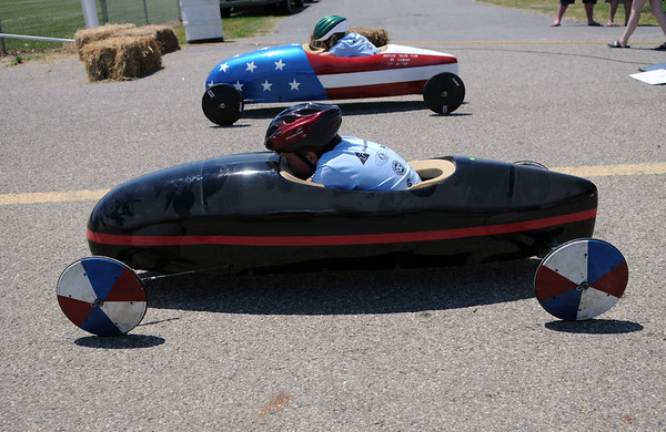 HALEY WARD | THE GOSHEN NEWS<br /> Madeline Hajicek and Kameron Kast race in the championship of the Super Stock division of the Elkhart County Soap Box Derby on Saturday at the Elkhart County Fairgrounds.