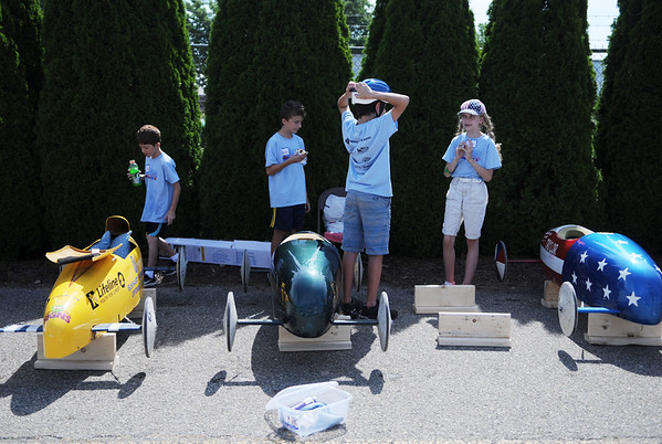 HALEY WARD | THE GOSHEN NEWS<br /> Children participating in the Elkhart County Soap Box Derby take a break in between races on Saturday at the Elkhart County Fairgrounds.