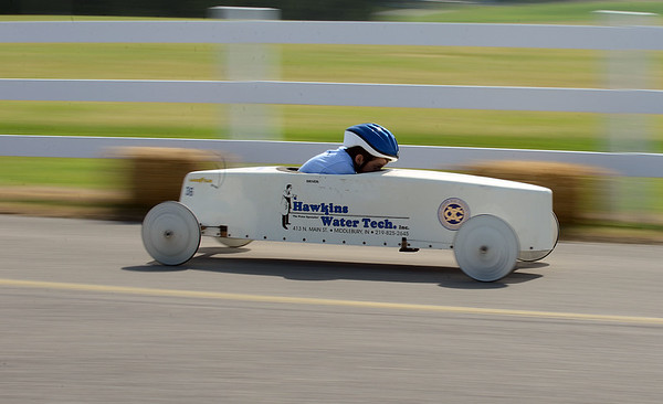 HALEY WARD | THE GOSHEN NEWS<br /> Austin Chupp races in a Stock division race during the Elkhart County Soap Box Derby on Saturday at the Elkhart County Fairgrounds.