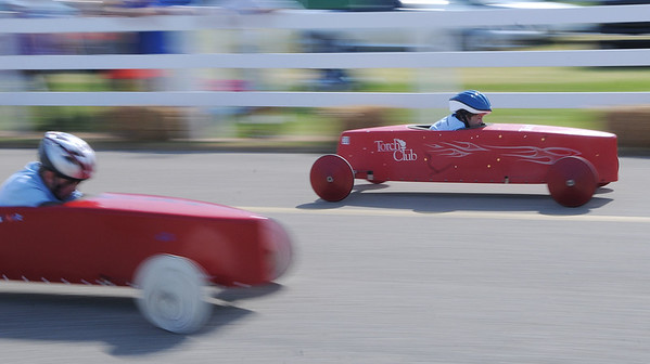 HALEY WARD | THE GOSHEN NEWS<br /> Cameron Lewis inches past Gavin Detweiller in the stock division of the Elkhart County Soap Box Derby on Saturday at the Elkhart County Fairgrounds.