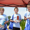 HALEY WARD | THE GOSHEN NEWS<br /> Collin Vidmar, Chad Kennedy and Ben Ramer, first to third place in the Masters division, stand with their trophies during the Elkhart County Soap Box Derby on Saturday at the Elkhart County Fairgrounds.