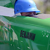 HALEY WARD | THE GOSHEN NEWS<br /> Ben Ramer peers out of the top of his car before a Masters division race of the Elkhart County Soap Box Derby on Saturday at the Elkhart County Fairgrounds. He finished third.