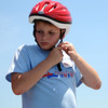 HALEY WARD | THE GOSHEN NEWS<br /> Reid Trussel puts his helmet on during the Elkhart County Soap Box Derby on Saturday at the Elkhart County Fairgrounds.