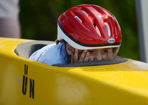 HALEY WARD | THE GOSHEN NEWS<br /> Journey Hackler peeks over her car before starting the race during the Elkhart County Soap Box Derby on Saturday at the Elkhart County Fairgrounds. She finished third in the Stock division.