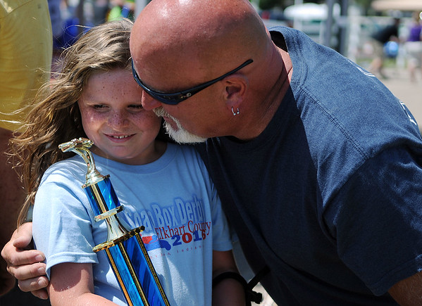 HALEY WARD | THE GOSHEN NEWS<br /> Rick Whipple embraces his daughter Jaidyn, 9, after she won the Stock division of the Elkhart County Soap Box Derby on Saturday at the Elkhart County Fairgrounds.