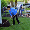 Roger Schneider | The Goshen News<br /> Irma Rodriguez, owner of 411 Summit Street, performs some landscaping work at her home during the annual Help-A-House Community Work Day held Saturday.