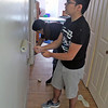Roger Schneider | The Goshen News<br /> <br /> Josue Vielman, front, and his sister Andrea Vielman, paint a wall at the Arbor Ridge Apartments Campus Center for Young Children during Help-A-House Saturday.