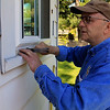 Roger Schneider | The Goshen News<br /> Tim Short, one of the owners of Zehr Constrution, volunteered his time Saturday during Help-A-House to oversee the installation of windows at the Irma Rodreguez home.
