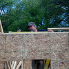 Roger Schneider | The Goshen News<br /> John Morris takes a measurement on a new storage shed Saturday at the Arbor Ridge Apartments Campus Center for Young Children. Morris was part of the volunteer crew from Encore Renovations.