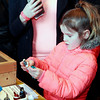 Brian Sapp | The Goshen News<br /> Livia Black, 6, of Bristol picks out several figurines to buy at the Comic Con.
