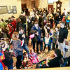 Brian Sapp | The Goshen News<br /> Comic Con fans wander through the lobby of The Lerner Theatre looking at displays of superhero memorabilia.