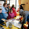 "Brian Sapp | The Goshen News<br /> Elle, 9, left, Erica, and Anna, 8, Truhn of South Bend wait for Michael ""Knightmare"" Wilson dressed as Panthro from the Thundercats to sign an autograph."