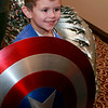 Brian Sapp | The Goshen News<br /> Asher Barber-Habick, 6,  of Elkhart, poses with Captian America's shield from the Hall of Hereos Marvel Movie props.