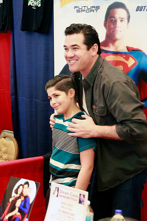 Brian Sapp | The Goshen News<br /> Dominic Barnett, 12, of Elkhart poses for a picture with Dean Cain who played Superman<br /> in the series Lois and Clark.