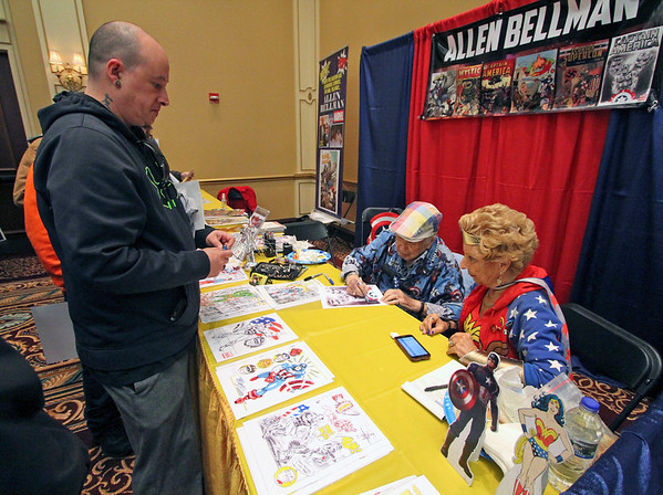 Roger Schneider | The Goshen News<br /> Joshua Martinez of Gsohen waits his turn for autographed artwork from Allen Bellman, 92, a comic book artist who was at the Hall of Heroes Comic Con.