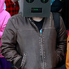 "Brian Sapp | The Goshen News<br /> Cody Magian of Benton Harbor, Michigan, going for the ""robot DJ"" look, waits in line to attend the<br /> first Hall of Heroes Comic Con."