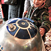 Brian Sapp | The Goshen News<br /> Gael Huerta, 6, of Elkhart smiles after R2D2 from Star Wars beeps at him.