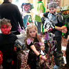 Briann Sapp | The Goshen News<br /> Alex Rodrigue, 7, left, Chloe Robinson, 6, Troy Robinson, 11, and Jacob Jensen, 11, show off their costumes for the cosplay contest at the Hall of Heroes Comic Con.