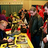 Brian Sapp | The Goshen News<br /> Trace Beaulieu, left,  the voice of Crow from Mystery Science Theatre 3000, signs an autograph for Brad and Mark Swift of Edwardsburg, Michigan.