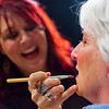 JAY YOUNG | THE GOSHEN NEWS<br /> Sarah Elizabeth Miller laughs while answering a question from the audience while she applies lipstick to her mother, Tammie Miller.