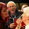 JAY YOUNG | THE GOSHEN NEWS<br /> BJ Miller laughs as he watches his granddaughter, Sarah Elizabeth Miller, left, apply aging makeup to his daughter, and Sarah's mother, Tammie Miller.