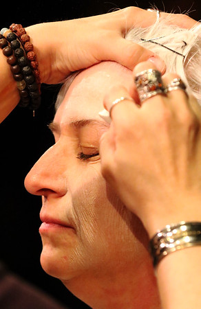 JAY YOUNG | THE GOSHEN NEWS<br /> Sarah Elizabeth Miller uses a sponge to apply make up to the left side of the face of her mother, Tammie Miller, in order to age her.