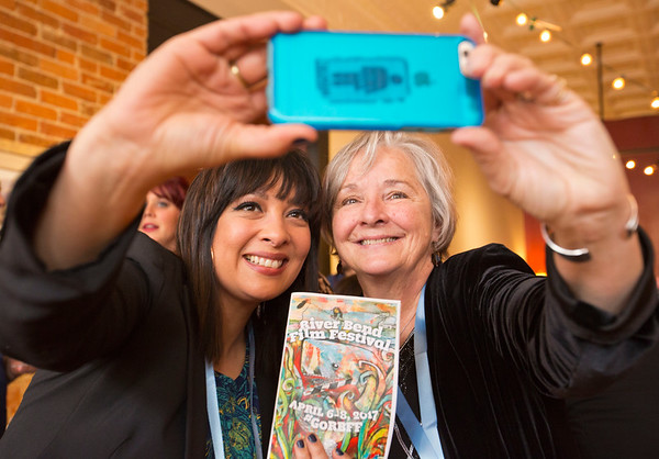 JAY YOUNG | THE GOSHEN NEWS<br /> Carrie Kendall, of Goshen, and Karen Jacob, of South Bend, take a selfie with a River Bend Film Festival brochure during the festival's opening party Thursday evening at Gateway Cellar Winery.