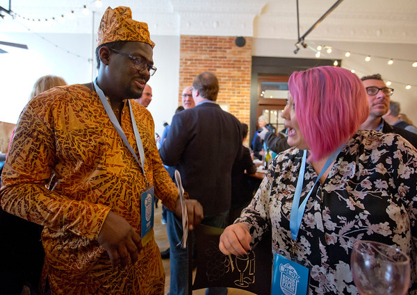 JAY YOUNG | THE GOSHEN NEWS<br /> Idris Busari, of Goshen and Bobbie Harley, of Savannah, Georgia, chat during the River Bend Film Festival opening party Thursday evening at Gateway Cellar Winery.