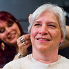 JAY YOUNG | THE GOSHEN NEWS<br /> Tammie Miller smiles as her daughter, Sarah Elizabeth Miller, applies tape to make the right side of Tammie's face look younger after aging the left side of her face.