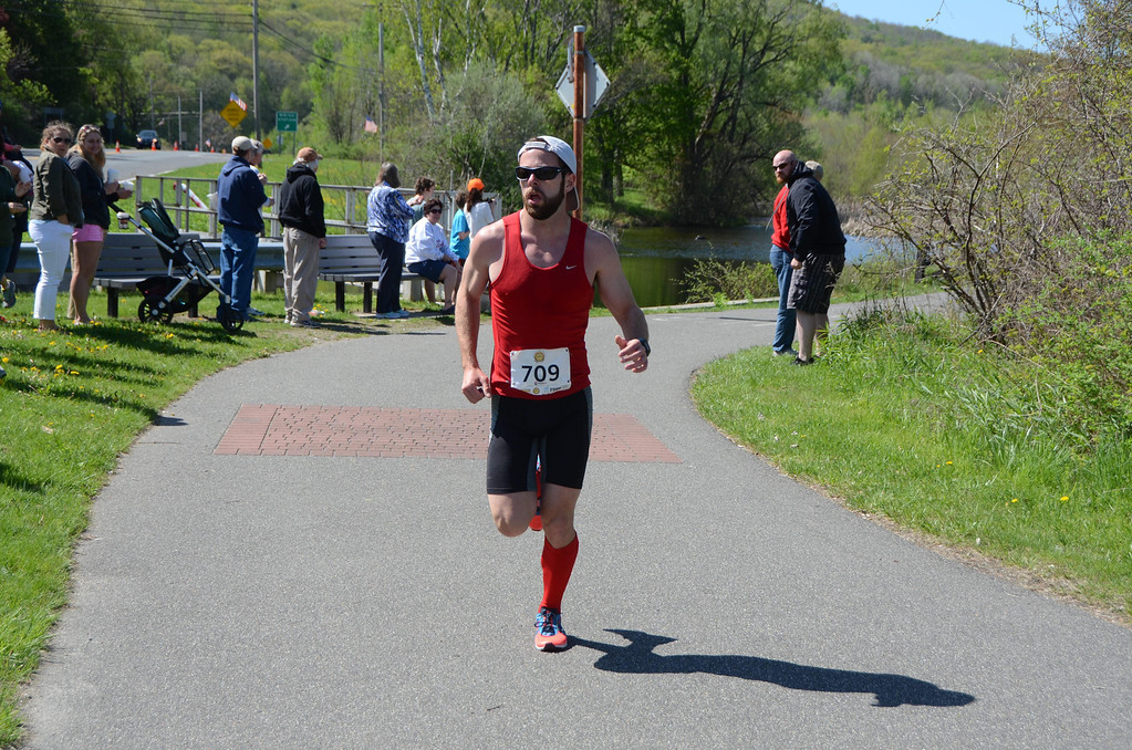 . Chris Plankey, who finished second in the BBC Steel Rail Half Marathon on Sunday, May, 18, 2014, crosses the near half way mark of the race near the intersection of Route 8 in Cheshire near the lake. Gillian Jones / Berkshire Eagle Staff / photos.berkshireeagle.com