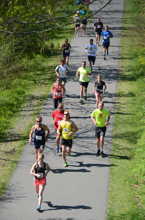 . Runners are seen on the Ashuwillticook Trail from Old State Road on the bridge over the trail as they compete in the BBC Steel Rail Half Marathon on Sunday, May, 18, 2014,  Gillian Jones / Berkshire Eagle Staff / photos.berkshireeagle.com