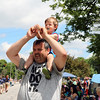 SHERRY VAN ARSDALL | THE GOSHEN NEWS Two-year-old Aaron Coti sits on the shoulders of his dad, Jeff Coti of Granger, while watching the 2016 Bristol Homecoming Parade Saturday.