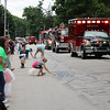 SHERRY VAN ARSDALL | THE GOSHEN NEWS Kids gather candy from area law enforcement and fire departments during the 2016 Bristol Homecoming Parade Saturday.